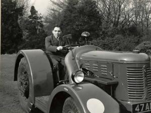 HM King Hussein in a David Brown tractor the day he visited Aston Martin to pick up his DB2. David Brown was a tractor manufacturer who bought the Aston Martin company.